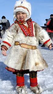Sami child in reindeer skin costume © Jørn Tomter/Finnmark Tourist Board
